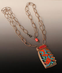 One-of-a-kind polymer pendant of reds, oranges, turquoise, with oxidized silver and coral bead at back.
