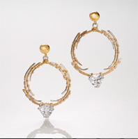 dangling silver hoop earrings with gold wrapped wire.