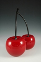 2 red cherries with black stems