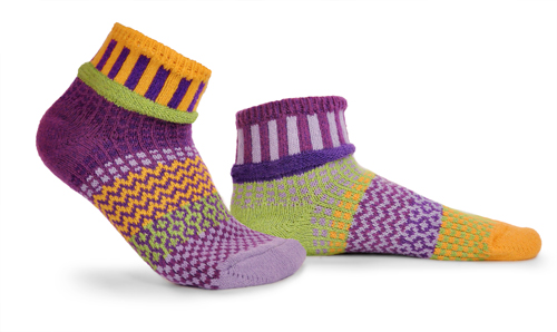 mismatched socks with lots of purple, lavender, yellow, and some light green.