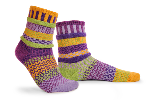 mismatched socks with lots of yellow, purple, some lavender,and light green.