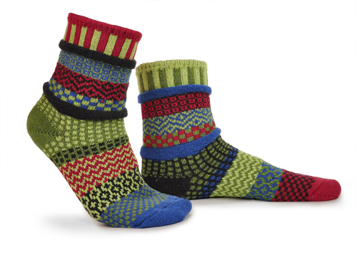 mismatched socks with dark reds, light and dark green, turquoise, little orange and yellow.