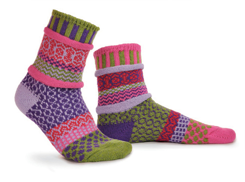 mismatched socks with pinks, red, light and dark green, blue.